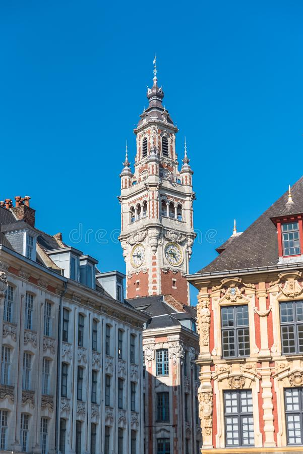 Lille, former facades in the center. Lille, old facades in the center, the belfry of the Chambre de Commerce in background stock images