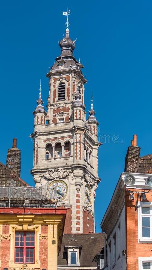 Lille, former facades in the center. Lille, old facades in the center, the belfry of the Chambre de Commerce in background royalty free stock photos