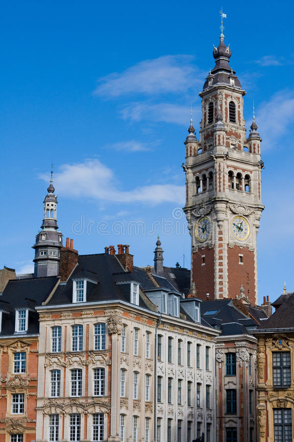 Lille, France. Tower of the Chambre de commerce and historic houses in Lille, France stock photos