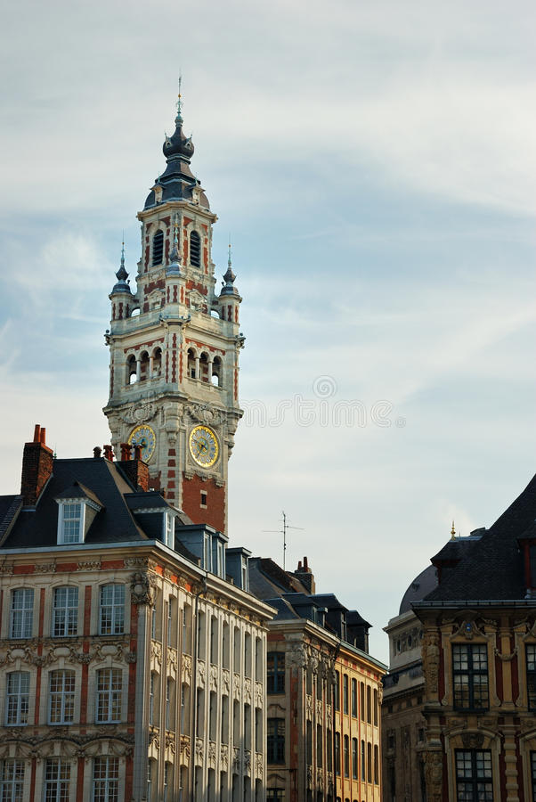 Lille, France. Tower of the Chambre de commerce and historic houses in Lille, France stock photo