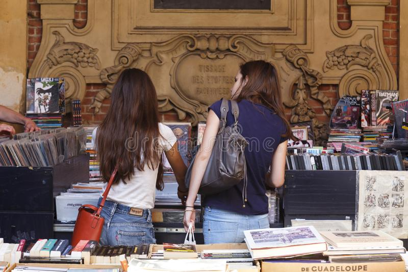 La Vieille Bourse de Lille. Lille, France - July 20, 2013. Tourists browse at a market stall selling books and vinyl records in La Vieille Bourse de Lille, the royalty free stock photos