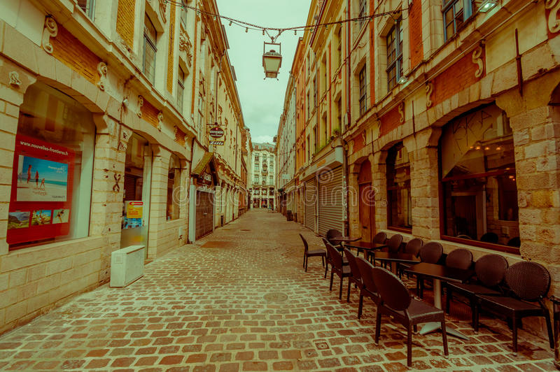 Lille, France - June 3, 2015: Side street from beautiful Place Grande with its charming buildings and traditional royalty free stock photo
