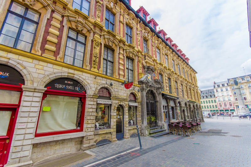 Lille, France - June 3, 2015: Side street from beautiful Place Grande with its charming buildings and traditional stock image