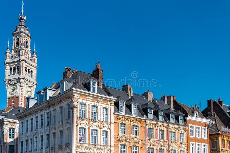 Lille, France. Lille, old facades in the center, the belfry of the Chambre de Commerce in background royalty free stock image