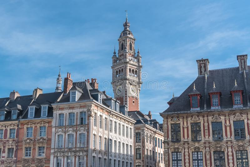 Lille, former facades in the center. Lille, old facades in the center, the belfry of the Chambre de Commerce in background stock photos