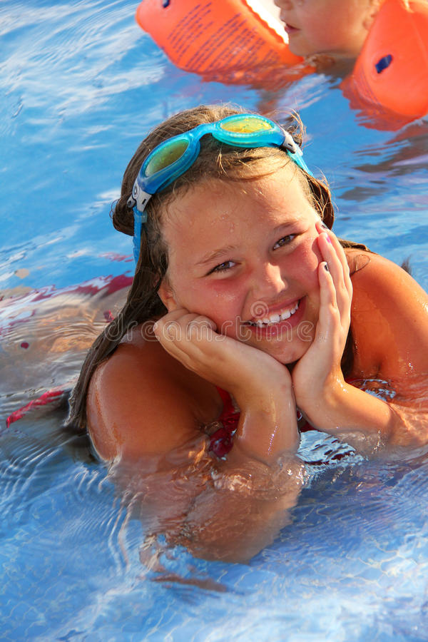 Download Lillte Girl in the pool stock photo. Image of child, blue - 26788018