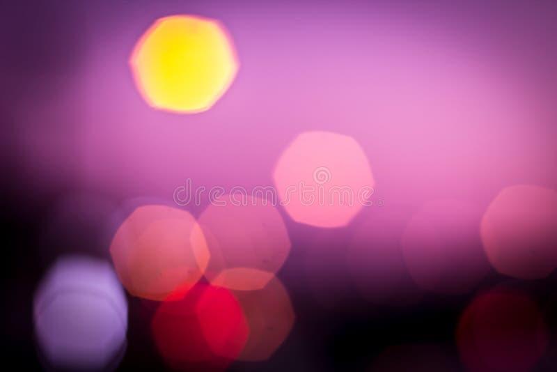 Lilor blured bokeh arkivbilder