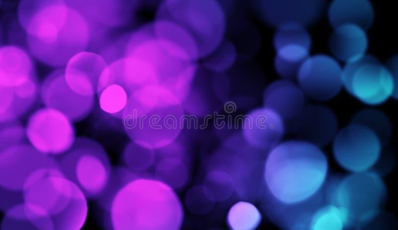 Lilor vs blå abstrakt bokehtextur Blänka färgrikt ljus royaltyfria foton