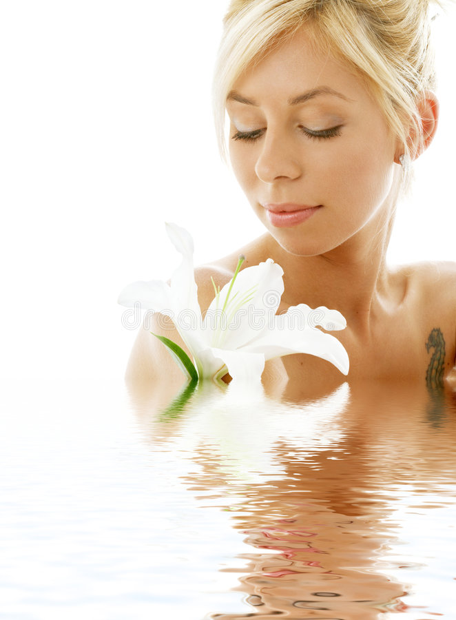Lily blond in water. Pretty lady with madonna lily in water stock photography