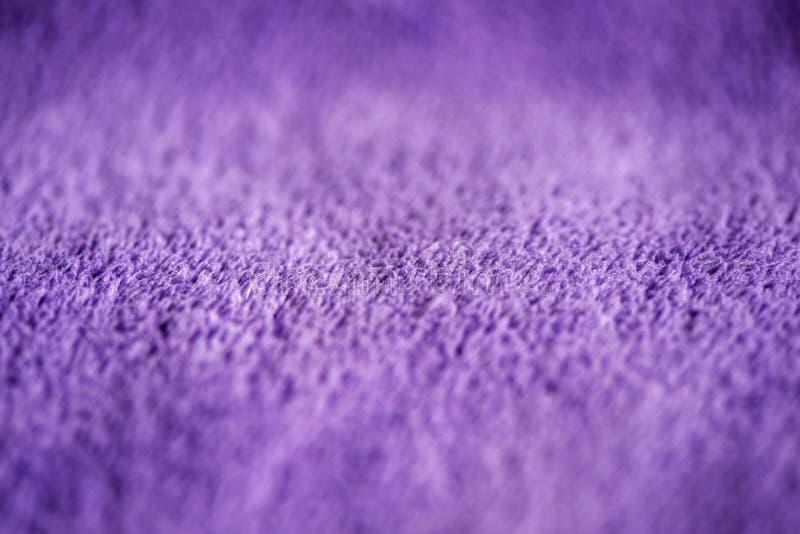 Lily delikatny mi?kki t?o futerkowego mokietu g?adka tkanina Tekstura purpurowa mi?kka we?nista powszechna tkanina obraz royalty free