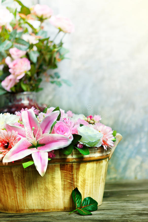 Lily flower bouquet and roses decorated by arrangement in wood bucket vertical form use as home decoration nature flora theme. File lily flower bouquet and roses stock images