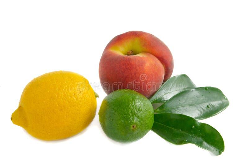Limão, cal e pêssego fotos de stock
