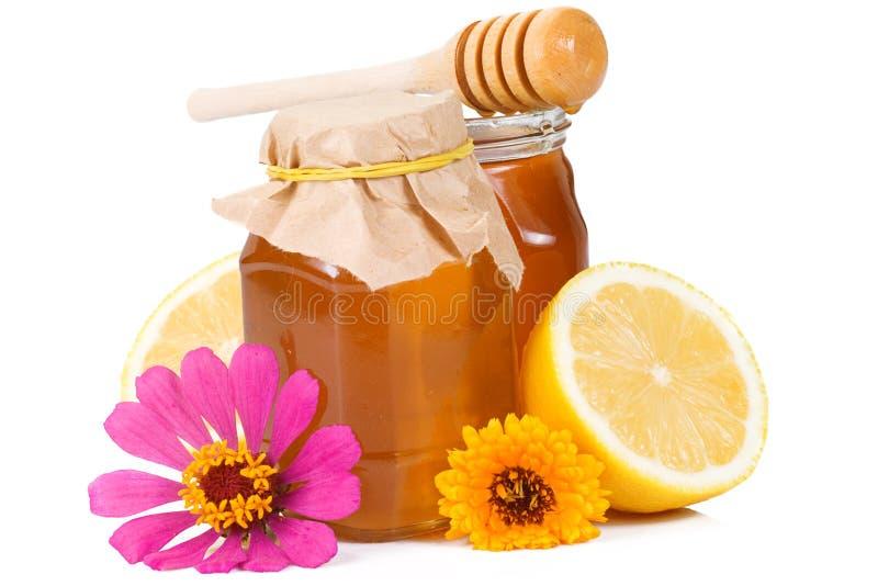 Limão e vidro do mel imagem de stock royalty free