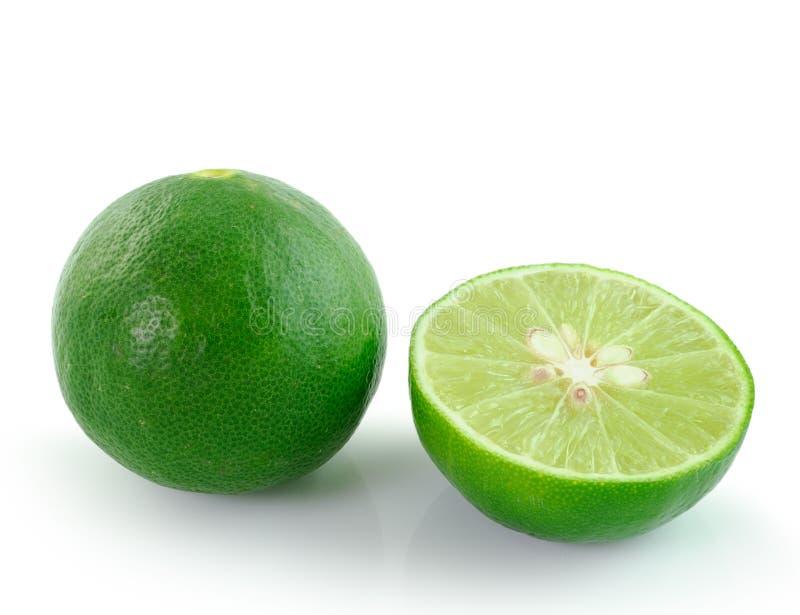 Limão verde no fundo branco fotografia de stock royalty free