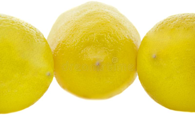 Limón amarillo fresco tres aislado sobre blanco fotografía de archivo libre de regalías