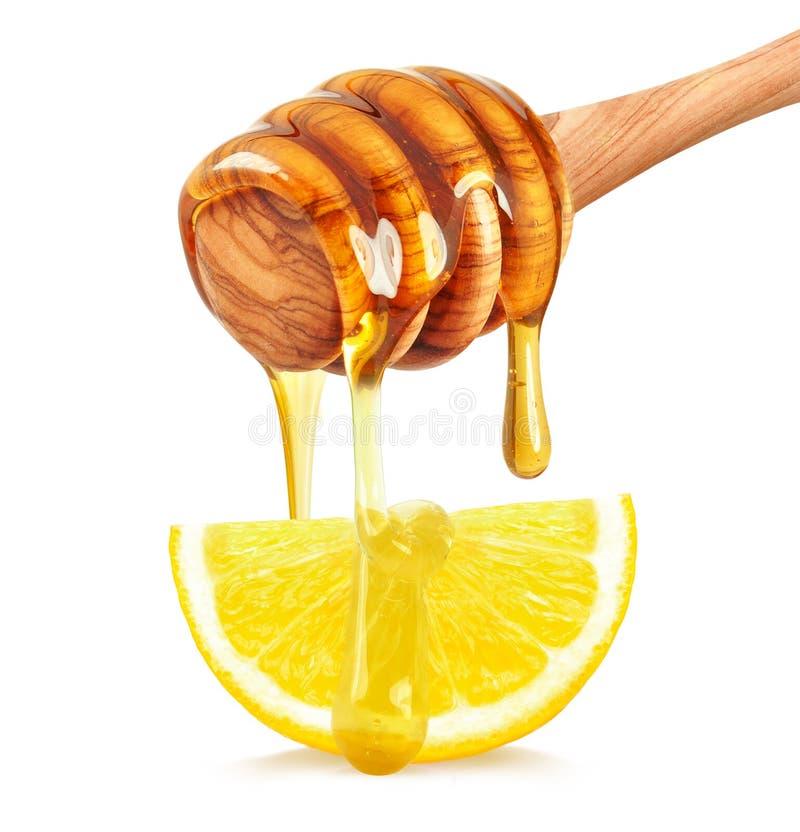 Limón con la miel imagen de archivo