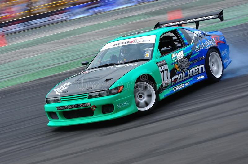 Lim Chien Wei drifting at Formula Drift 2010. Lim Chien Wei from Falken Stamford team drifting at Singapore Formula Drift 2010 at F1 Pit Building on 24 Apr 2010 stock photography