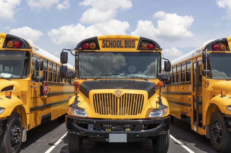 Yellow School Bus in a District Lot Waiting to Depart for Students stock photos
