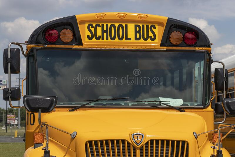 Yellow School Bus in a District Lot Waiting to Depart for Students royalty free stock photos