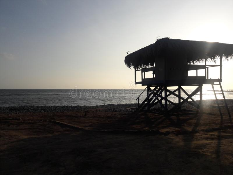 Lima Peru beach lifeguard stand hut silhouette at dusk royalty free stock image