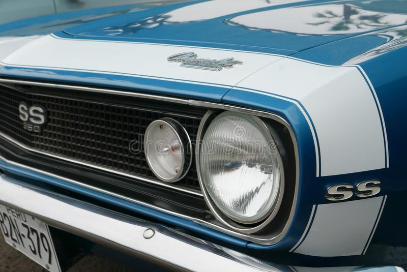 Classic Chevrolet Camaro SS 350 1967 in Lima. Lima, Peru. January 17, 2018. Close up of the front and side view of a blue and white color mint condition stock image