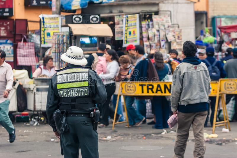Lima / Peru Jun 13.2008: Peruvian Policeman in the uniform controlling the traffic on the street royalty free stock photo