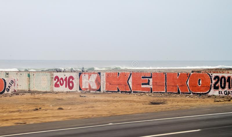 LIMA, PERU - JUNE 3, 2015: Posters on walls during the presidential campaing of the candidate Keiko Fujimor stock image