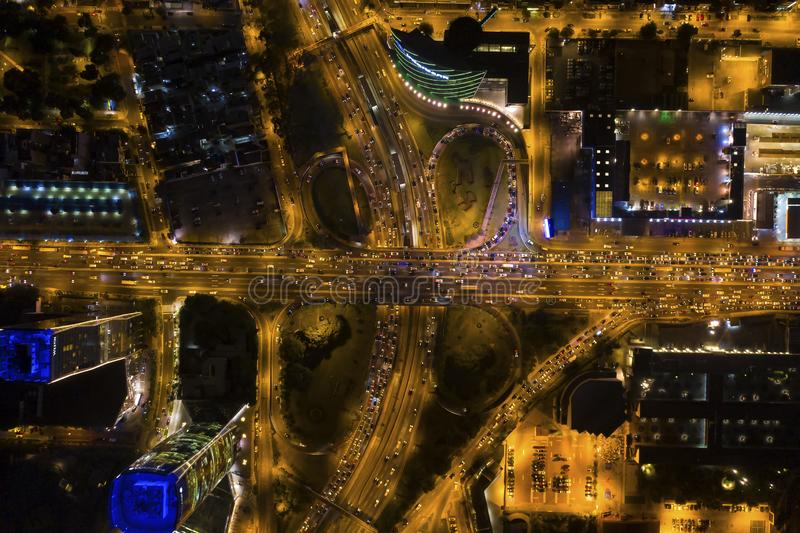 Aerial top view of cloverleaf  Interchange road at rush hour. Lima, Peru - March 21 2019: Aerial top view of cloverleaf  Interchange road at rush hour. Birds royalty free stock photography