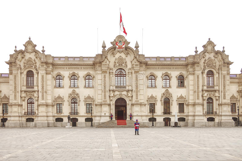 LIMA, PERU - OCTOBER 31, 2011: Government palace with guards. At Plaza de Armas in Lima, Peru. It is the birthplace of the city of Lima, as well as the core of royalty free stock photos