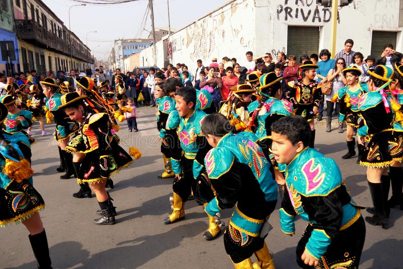 Lima Peru/8th September 2013/Young boys and girls perform tradit. Ion street dances in authentic costumes ahead of a religious procession royalty free stock image