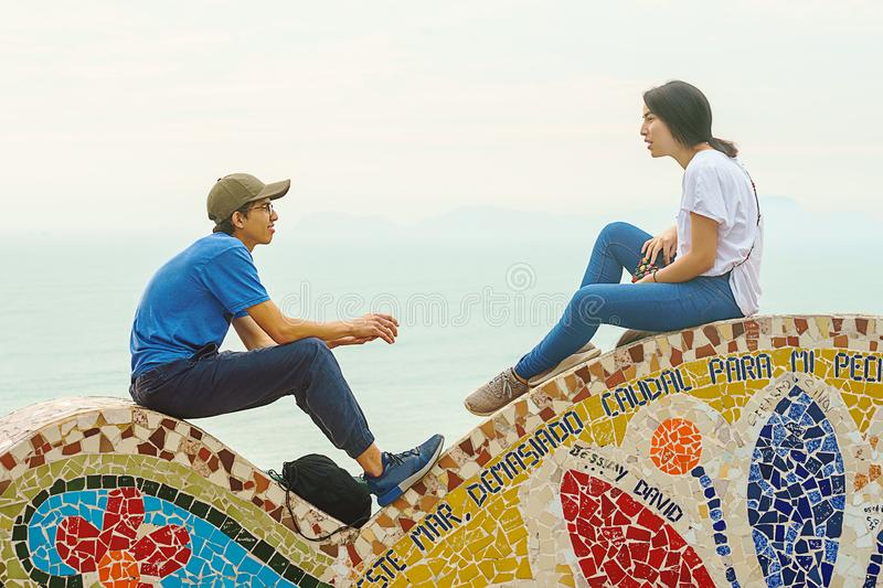 Lima, Peru - 03.18.2019 Couple on a sunny day in the park of love in Miraflores. royalty free stock images