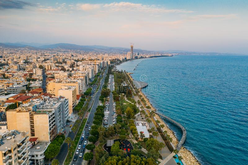 Limassol aerial view, Cyprus. Promenade or embankment with alley, palms and buildings. Drone photography. Beautiful royalty free stock photo