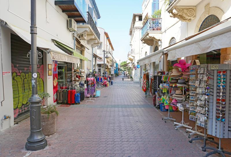 Street in the downtown of Limassol city with stores and traditional Cypriot architecture royalty free stock photo