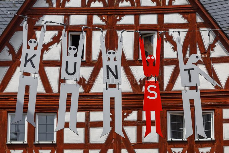 Decoration of half-timbered facades in the old town of Limburg, Germany. LIMBURG / GERMANY - JUNE 2015: Decoration of half-timbered facades in the old town of stock images