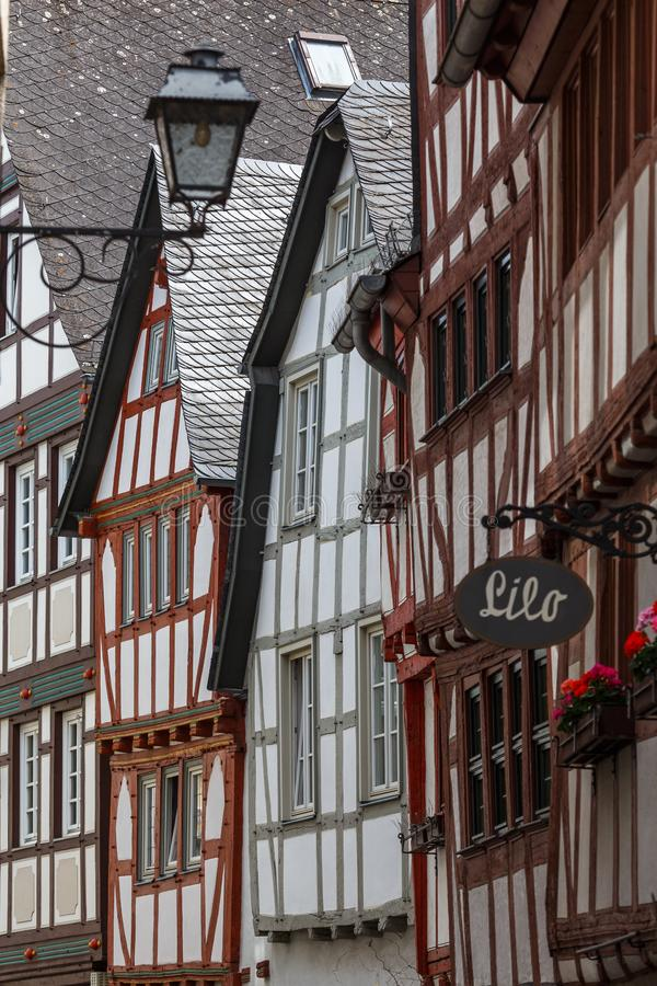 Half-timbered facades of the old town of Limburg, Germany. LIMBURG / GERMANY - JUNE 2015: Half-timbered facades of the old town of Limburg, Germany stock photo