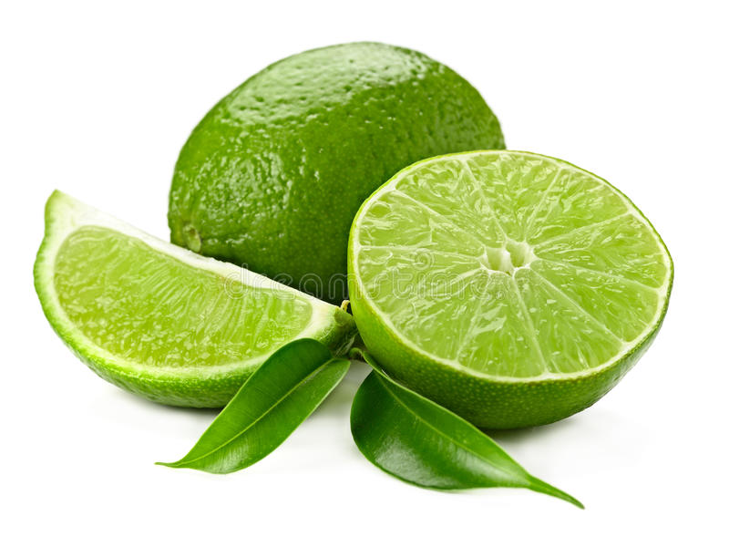 Lime. Llime and leaves isolated on white stock image