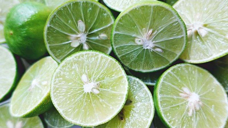 Lime Background. Close up shot of limes. Selective Focus of sliced lime. Lime is a kind of fruit. The result is very sour. stock photography