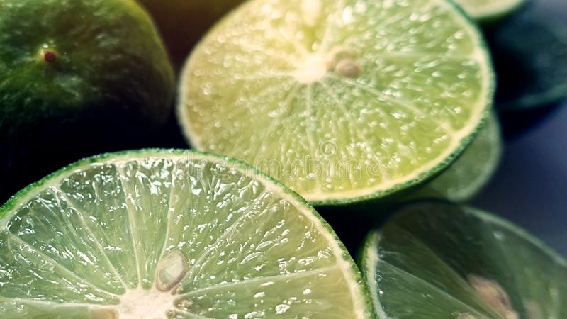 Lime Background. Close up shot of limes. Selective Focus of sliced lime. Lime is a kind of fruit. The result is very sour. royalty free stock image