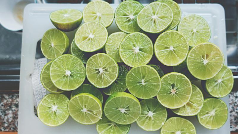 Lime Background. Close up shot of limes. Selective Focus of sliced lime. Lime is a kind of fruit. The result is very sour. royalty free stock photo