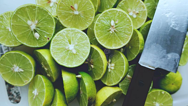 Lime Background. Close up shot of limes. Selective Focus of sliced lime. Lime is a kind of fruit. The result is very sour. royalty free stock photos