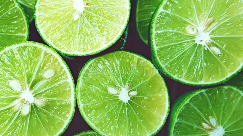 Lime Background. Close up shot of limes. Selective Focus of sliced lime. Lime is a kind of fruit. The result is very sour. royalty free stock photography