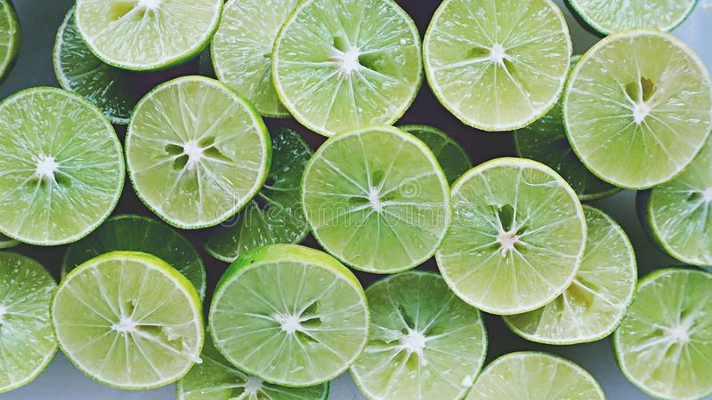 Lime Background. Close up shot of limes. Selective Focus of sliced lime. Lime is a kind of fruit. The result is very sour. stock photos