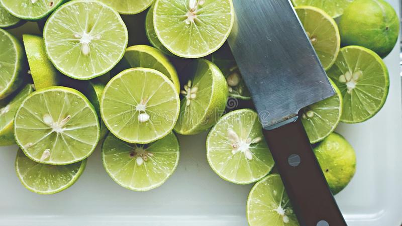 Lime Background. Close up shot of limes. Selective Focus of sliced lime. Lime is a kind of fruit. The result is very sour. royalty free stock images