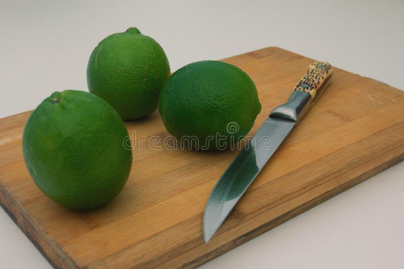 lime on wooden board background royalty free stock photography
