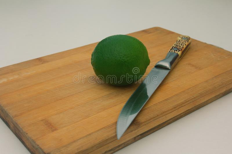 lime on wooden board background stock photo