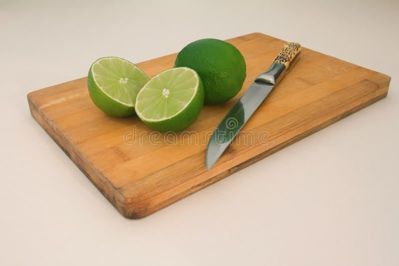 lime on wooden board background stock photos