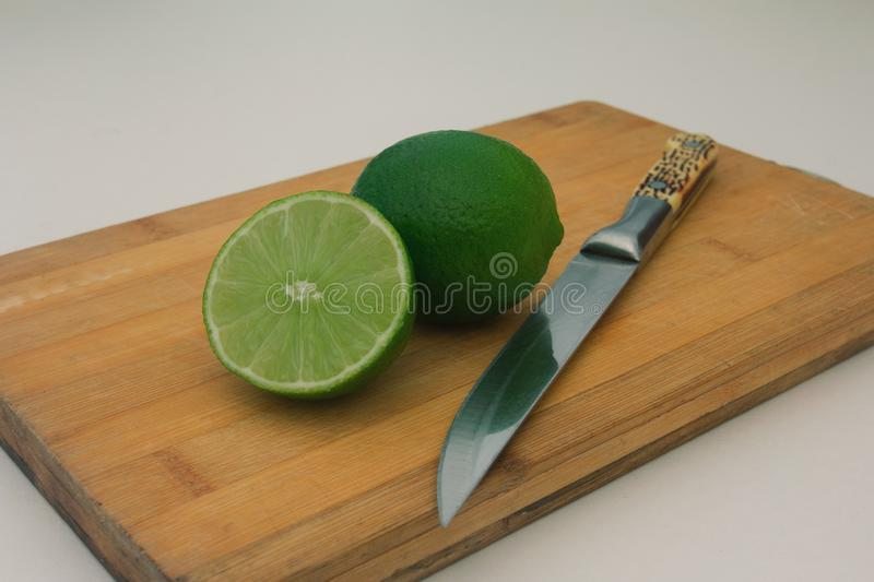 lime on wooden board background stock images