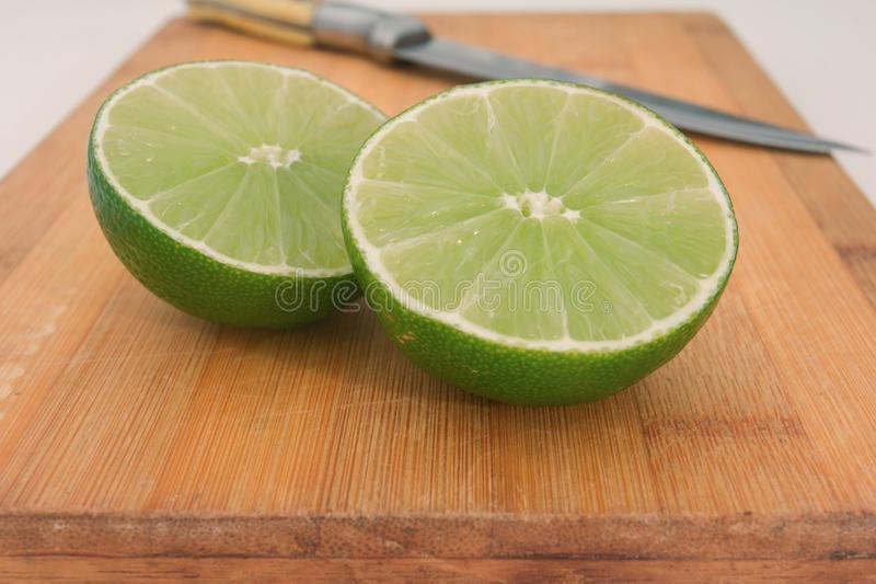 lime on wooden board background royalty free stock images