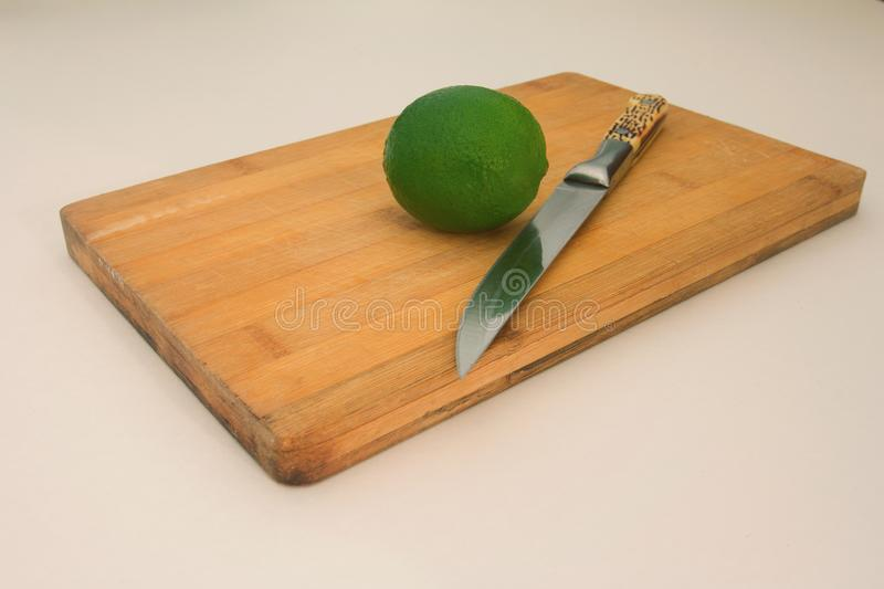 lime on wooden board background stock image