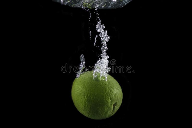 Lime with bubble trail royalty free stock image